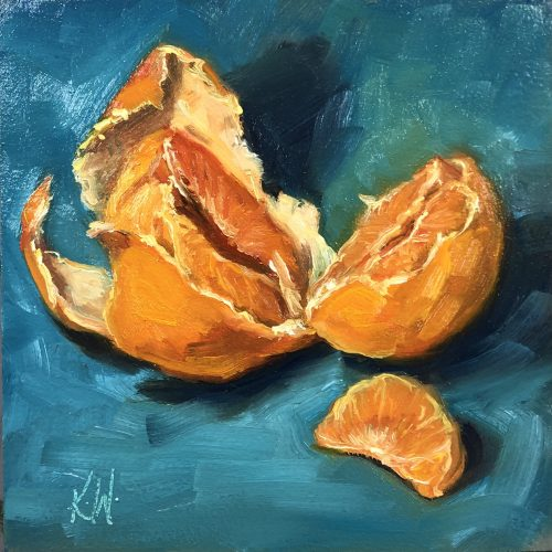 mandarin orange still life on a blue background