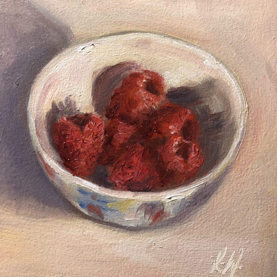 Raspberries in a blue bowl still life